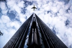 Airplane flying over building
