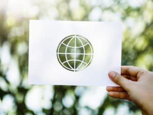 Hand Carrying A Piece of Paper of the World