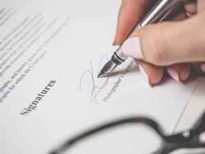 Silver pen signing signature